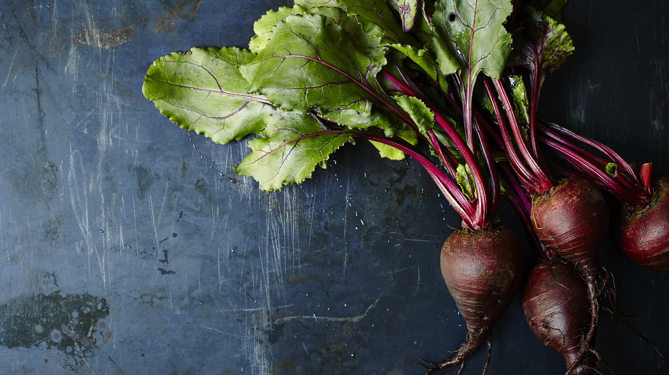Image of beets. Beets are an excellent source of nitrates, which are converted to nitric oxide within the body. Nitric oxide relaxes and dialtes blood vessels and dilates, helping the blood flow more easily and lowering blood pressure.